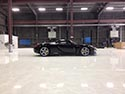 White Glossy Epoxy Flooring in a Luxury Car Showroom