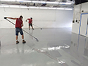 Men Installing an Epoxy Floor Coating