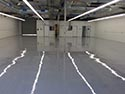 Industrial Concrete Floor with Reflection of Lights