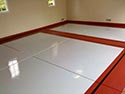 Red and White Concrete Floor Epoxy Coating