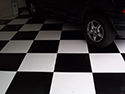 Checkerboard Garage Floor Coating with Car