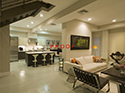 Residence Kitchen and Living Area with White Concrete Epoxy Floors