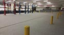 Empty Service Center with Garage Epoxy Flake Flooring