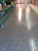 Close Up of Roll On Rock Epoxy Flake Flooring