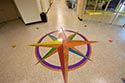 Epoxy Flake Floor with Decorative Compass Emblem