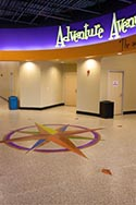 Decorative Flake Flooring with Compass Emblem